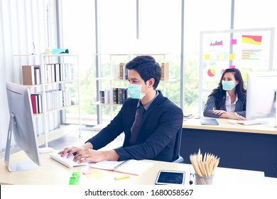 Businessman or office worker are working and wear mask for protect Covid-19 or corona virus disease but business must be continuous, healthcare concept