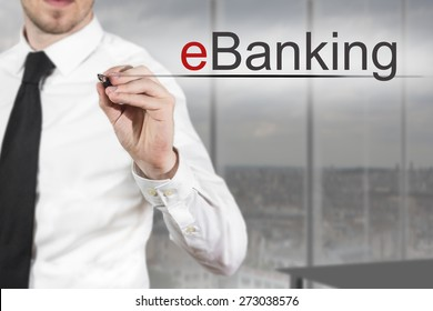 businessman in office writing eBanking in the air