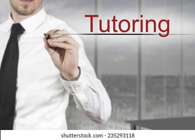 businessman in office writing tutoring in the air