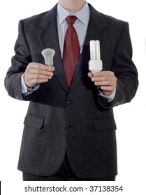 Businessman with old and energy-saving light bulbs isolated on the white