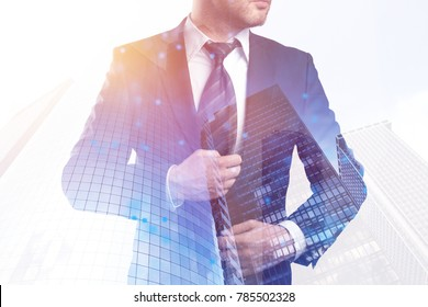 Businessman on abstract city background with polygonal mesh. Network, communication and future concept. Double exposure