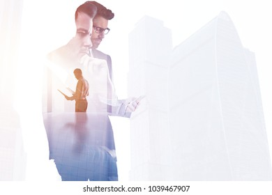 Businessman on abstract city office background. Success and network concept. Double exposure