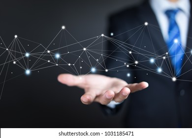 Businessman on background holding connections system and global datas exchanges. Business network connection concept.