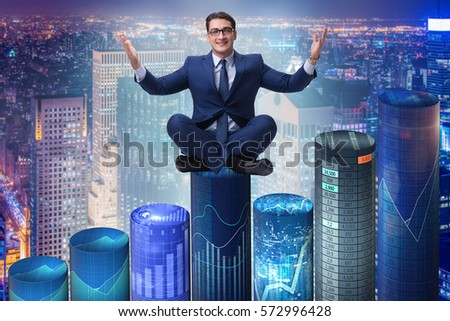Businessman on the bar charts in business concept