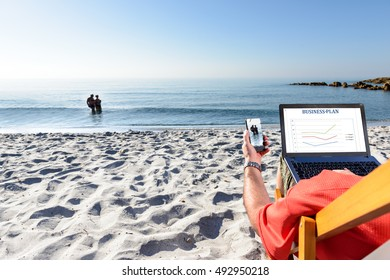 Businessman on the beach working with notebook and smart phone. / Relax or Work?