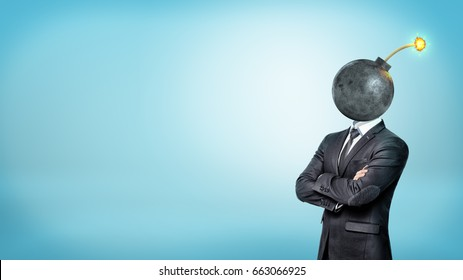 A businessman on blue background standing with his hands crossed with a bomb instead of his head. Identity and hiding. Corporate world. Troublemaker at work.