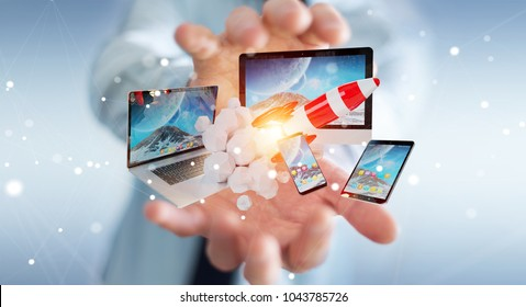 Businessman on blurred background connecting tech devices and startup rocket 3D rendering