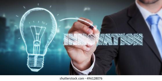 Businessman on blurred background drawing a sketch lightbulb innovation concept