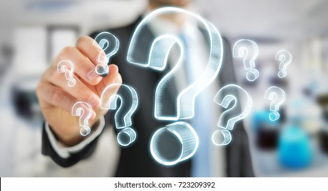 Businessman on blurred background drawing hand drawn question marks
