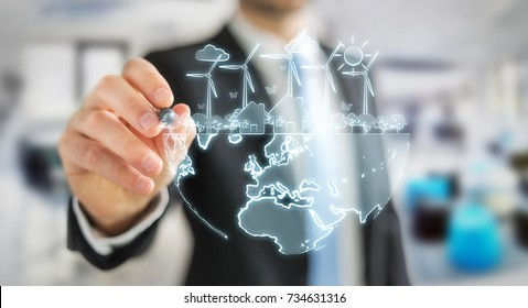 Businessman on blurred background drawing renewable energy sketch