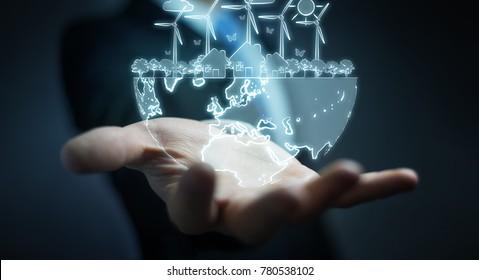 Businessman on blurred background hloding renewable energy sketch