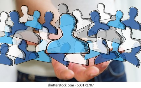 Businessman on blurred background holding hand drawn social network in his hand