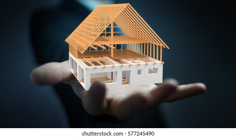 Businessman On Blurred Background Holding 3D Rendering Unfinished Plan House  In His Hand