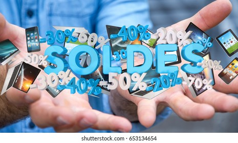 """Businessman on blurred background holding sales icons in his hand 3D rendering (""""soldes"""" means sales in french)"""