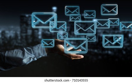 Businessman on blurred background holding and touching floating emails 3D rendering