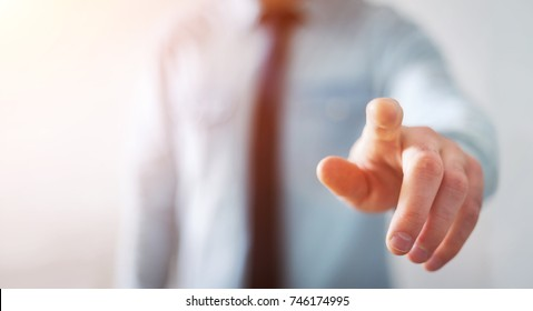 Businessman on blurred background pointing his finger