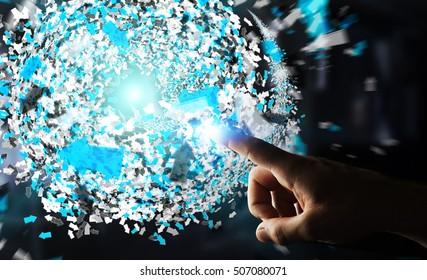 Businessman on blurred background touching 3D rendering data network sphere with his fingers