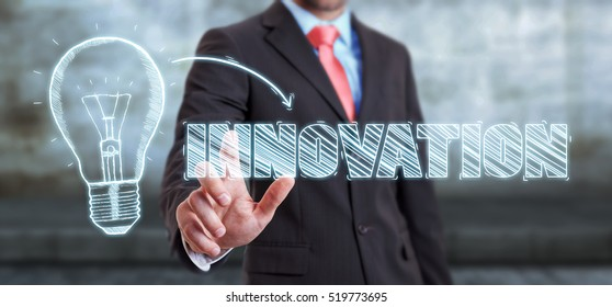 Businessman on blurred background touching a sketch lightbulb innovation concept