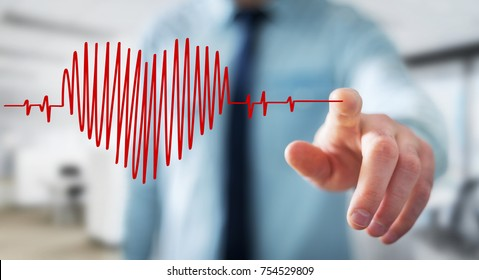 Businessman on blurred background touching and holding heart beat sketch