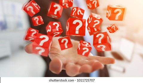 Businessman on blurred background using cubes with 3D rendering question marks