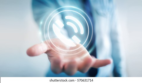 Businessman on blurred background using hotline customer assistance 3D rendering