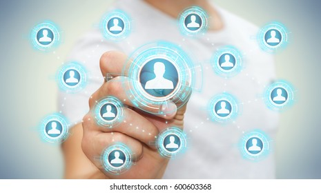 Businessman on blurred background using blue social network with a pen 3D rendering
