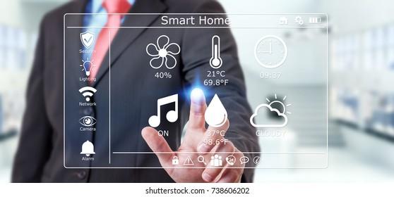 Businessman on blurred background using smart home digital interface