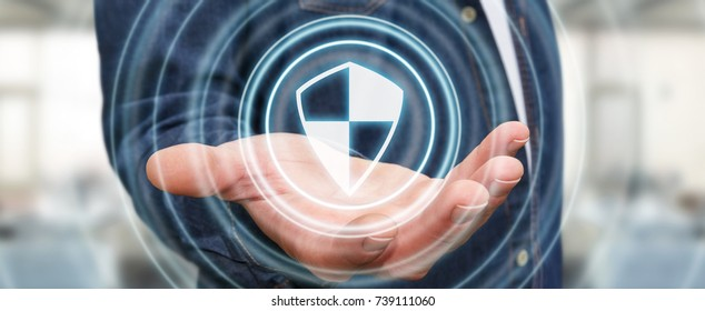 Businessman on blurred background using shield safe protection to protect his datas