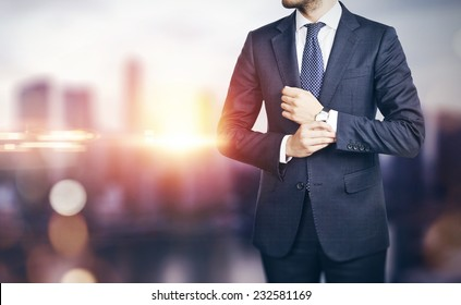 Businessman on blurred city background