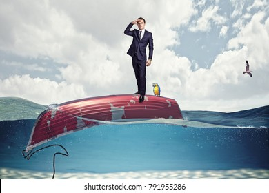 businessman on boat upside down crisis concept image