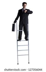 Businessman on corporate ladder checking wristwatch