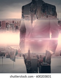 Businessman on creative upside down red city background. Double exposure