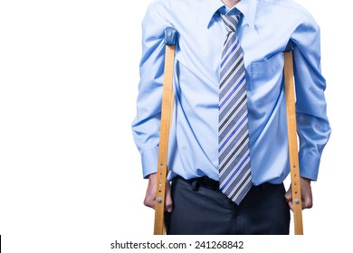 businessman on crutches, isolated on white.
