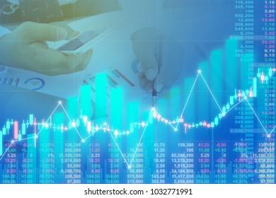 Businessman on digital stock market financial positive growing indicator. Double exposure growth digital futuristic chart business funds market strategy. stock market financial indices goal analysis