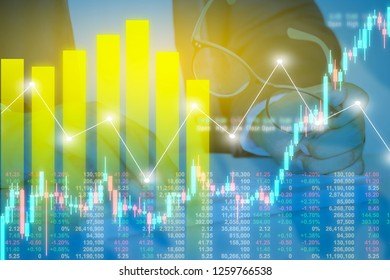 Businessman on digital stock market financial positive indicator background. Double exposure of growth graph futuristic economic currency chart investor data analysis money exchange technology concept