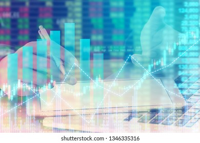 Businessman on digital stock market financial positive indicator background. Double exposure of growth graph futuristic economic currency chart investor data analysis money exchange technology concept - Shutterstock ID 1346335316