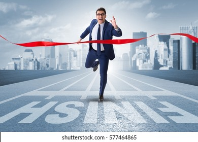 Businessman on the finishing line in competition concept