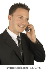 A businessman is on his cell isolated on a white background.