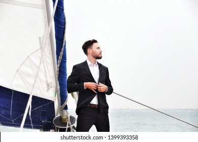 Businessman on luxury yacht, handsome man wearing suit on sailing boat