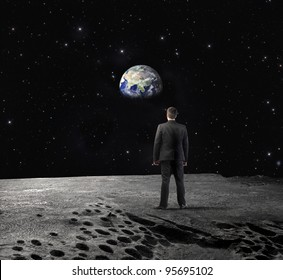 "Businessman on the Moon observing the Earth in the background ""Elements of this image furnished by NASA"""