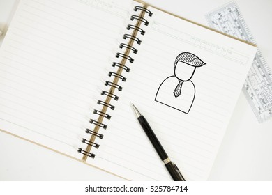 businessman on notepad