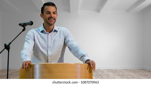 Businessman on podium speaking at conference in room