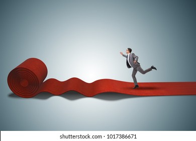 Businessman on the red carpet in success concept