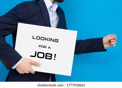 """Businessman on the run with white board with """"looking for a job"""" sign. Business conception of searching for a job."""
