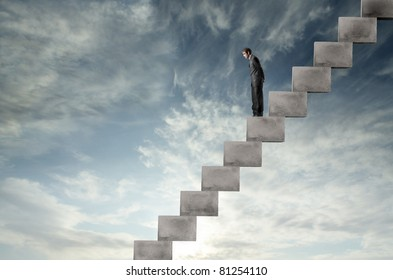 Businessman on a stairway looking downwards