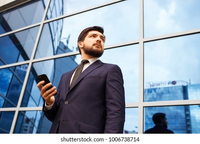 businessman on the street with phone