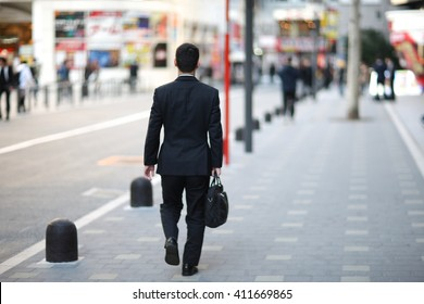 Businessman on the streets of Megalopolis