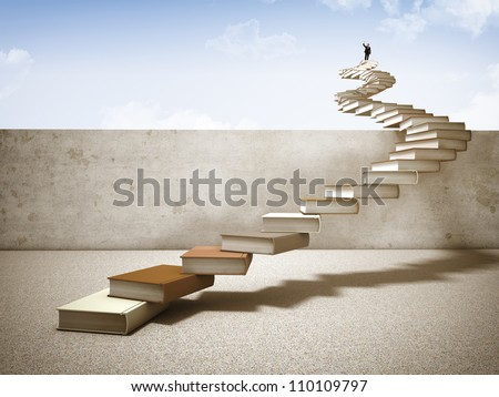 businessman on top of books stair