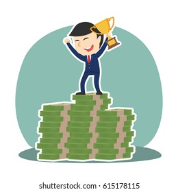 businessman on top of money stacks with trophy