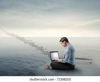 Businessman on a wharf using a laptop and numbers flying away from it